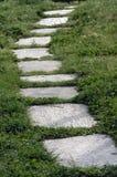 图象路径向垂直扔石头 库存照片