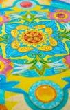 图画在一块帆布的油漆与花卉和图表装饰品 免版税图库摄影