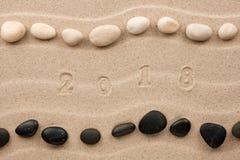 图2018年版本记录在沙子 免版税图库摄影