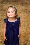 圆点礼服的亲爱的小女孩 免版税图库摄影