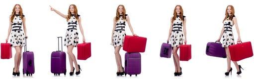 圆点礼服的美女带着在wh隔绝的手提箱 免版税库存图片