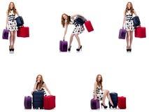 圆点礼服的美女带着在wh隔绝的手提箱 免版税库存照片