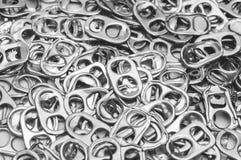 圆环罐头拉扯铝,背景 库存图片
