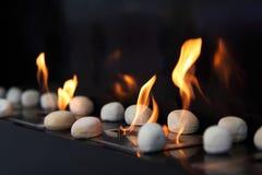 圆的壁炉发火焰石头 免版税库存照片