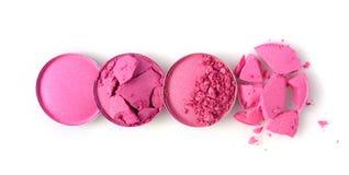 圆的桃红色击碎了眼影膏为组成作为化妆产品样品  免版税库存图片