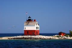 圆的海岛灯塔 免版税图库摄影