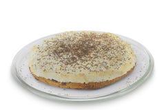 圆的自创蛋糕用在白色背景隔绝的巧克力 图库摄影