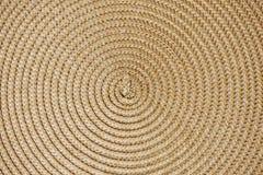 圆的被编织的秸杆背景 免版税图库摄影