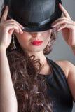 圆顶硬礼帽的女孩 免版税库存图片