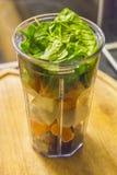 圆滑的人杯子用新鲜水果、菜和牛奶 免版税库存照片