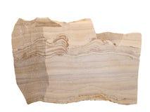 黏土、沙子、氧化钢和其他杂质镶边的石灰石自然样品在白色背景 免版税库存照片
