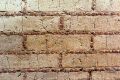 黏土墙壁纹理,划分由小的石头 免版税库存照片