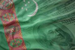 土库曼斯坦五颜六色的挥动的国旗美国美元金钱背景的 库存照片