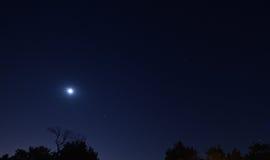 土星月亮毁损木星 免版税图库摄影