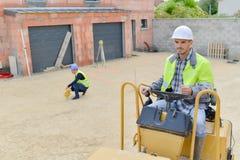 土木工程师在建筑工地 免版税库存照片