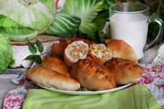 土气静物画用饼、圆白菜和牛奶 免版税库存图片