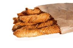 土耳其曲奇饼stiks用在白色背景和向日葵种子隔绝的芝麻 库鲁面团 Kurabiye 库存图片