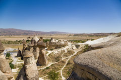 土耳其,卡帕多细亚 在Pashabag谷(修士谷)的异乎寻常的岩石 免版税库存图片