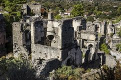 土耳其, Kayakoy鬼城,被放弃的房子,特写镜头描述墙壁被毁坏的hous 库存图片