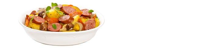 土豆和香肠晚餐 全景的图象 免版税图库摄影