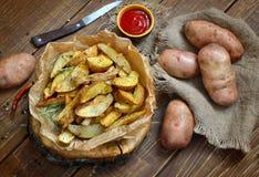 土豆楔住用在残余部分的果皮油炸物 库存照片