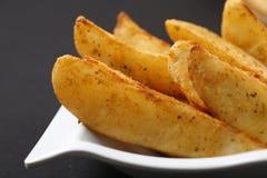 土豆楔子 库存照片
