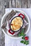 土豆花椰菜焦干酪。 免版税库存照片