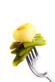 土豆重点和青豆 图库摄影