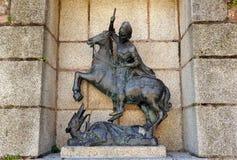 圣乔治和龙,铜雕塑,卡塞里斯,埃斯特雷马杜拉,西班牙 免版税库存照片