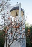 从圣佩特卡教会的钟楼的冻柿子在Rupite,保加利亚 免版税库存照片