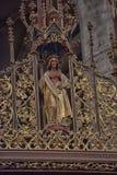 圣徒的被雕刻的木雕塑 库存图片