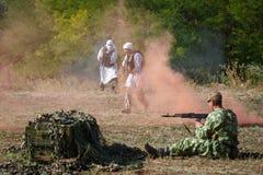 圣战者攻击苏联士兵的位置 免版税库存照片