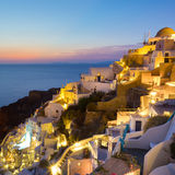 圣托里尼的Oia村庄日落的,希腊 库存图片