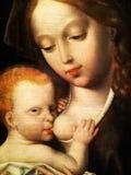 圣母玛丽亚和儿童在盘区的油画 免版税库存图片