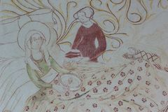 圣母玛丽亚在诞生以后的床上,吃粥 库存照片