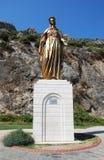 圣母玛丽亚的古铜色雕象 图库摄影