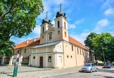 圣洁发怒近的总统府在1543年建造的,维尔纽斯,立陶宛的教会 免版税库存图片