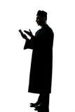 圣经人教士读取剪影 库存图片