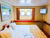 圣胡安,波多黎各- 2016年5月08日:与两扇舷窗的里面客舱在狂欢节游轮迷恋 免版税库存照片