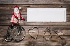 圣诞卡或广告标志与红色和白色装饰 免版税库存照片