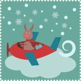 圣诞卡用兔子圣诞老人 库存图片