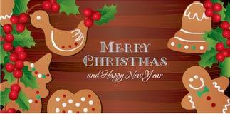 圣诞卡用圣诞节姜饼和霍莉 免版税库存图片