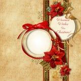 圣诞快乐。与frame&poinsettia的葡萄酒卡片 免版税库存照片
