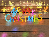 圣诞快乐与天使的颜色看板卡 免版税库存照片