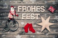 圣诞快乐与德国文本的贺卡-红色圣诞老人和w 免版税库存照片