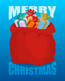 圣诞快乐充分的圣诞老人大袋礼物 袋子与前 库存照片