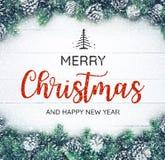 圣诞快乐和新年快乐印刷术,与圣诞节装饰品的文本 免版税库存照片