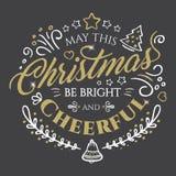 圣诞快乐和新年快乐的书法字法与对黑暗的背景的金黄闪烁作用 库存照片