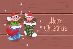 圣诞快乐和新年快乐贺卡圣诞老人Elfs垂悬 库存例证
