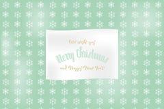 圣诞快乐在与雪花和手写的文本的浅绿色的背景上标记 向量例证